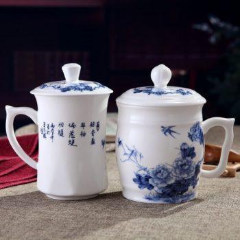 CBDI41-B-01手工高档骨瓷青花富贵花开图文夫妻对杯 品茗杯 和谐杯尺寸:左 口径 8.5cm 高 15.5cm 容量 约500ml 右 口径 9.5cm 高 15cm 容量约 550ml